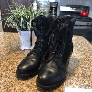 Black tie up boots, with zipper on inner side
